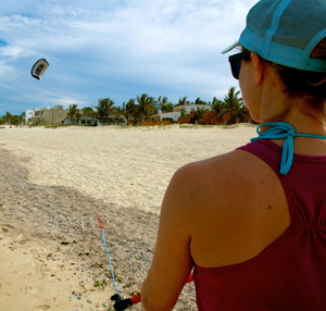Beach-bound, practicing on a training kite